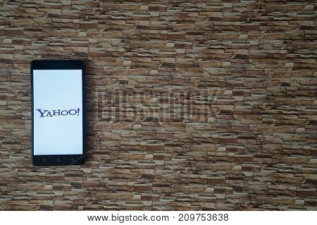 Los Angeles, USA, october 19, 2017: Yahoo logo on smartphone screen on stone facing background