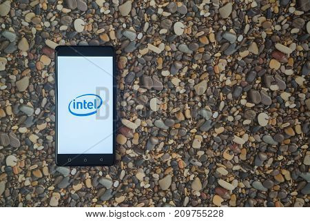 Los Angeles, USA, october 18, 2017: Intel logo on smartphone on background of small stones