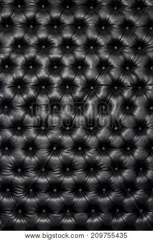 Luxurious black shiny leather texture furniture, club entertainment.