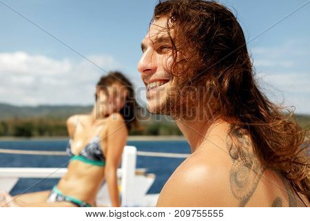 Indonesia Bali - September 24 2017: A guy and a girl are traveling on a yacht between the islands of Indonesia