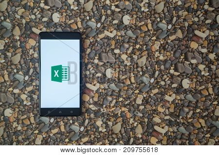 Los Angeles, USA, october 18, 2017: Microsoft office excel logo on smartphone on background of small stones