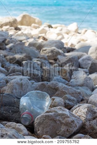 Plastic bottle is on the beach left by tourist. Turkey