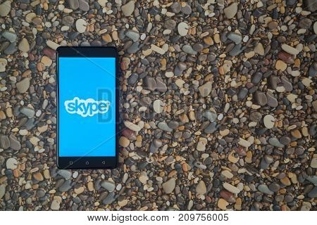 Los Angeles, USA, october 18, 2017: Skype logo on smartphone on background of small stones