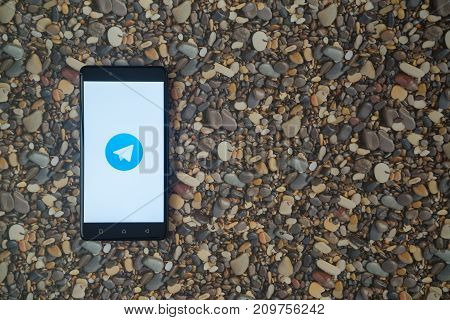 Los Angeles, USA, october 18, 2017: Telegram logo on smartphone on background of small stones