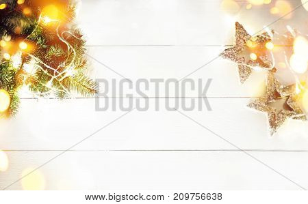 Christmas decorations on white wooden background. Christmas frame made of fir branches with copy space. Christmas  Flat lay top view