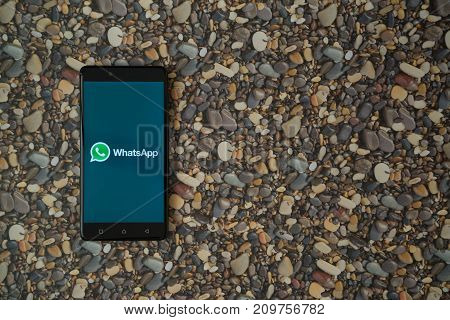 Los Angeles, USA, october 18, 2017: Whatsapp logo on smartphone on background of small stones