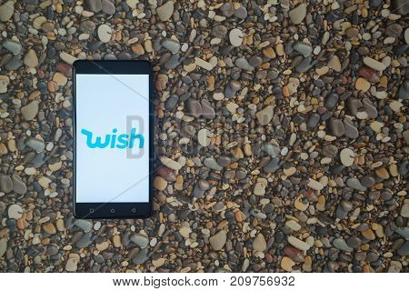 Los Angeles, USA, october 18, 2017: Wish logo on smartphone on background of small stones