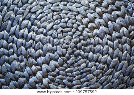 Round woven mat texture background in silver blue