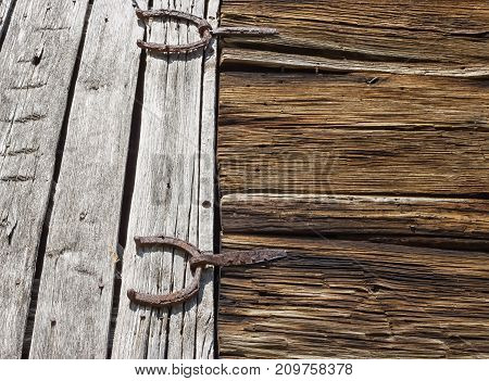 Antique barn door with horseshoes for hinges