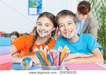 Happy smiling children table fun girl sitting