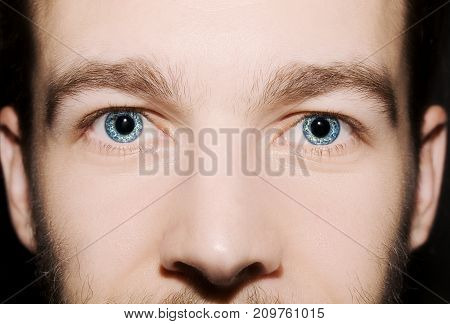 Image of man's blue eyes close up.