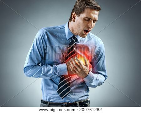 Office manager having heart attack. Medical concept.