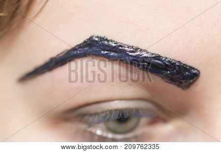 painted black eyebrows . photo in the studio
