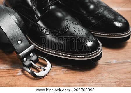 stylish men's accessories on the wooden background