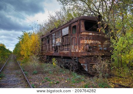 Hopeless post apocalyptic landscape. Cemetery of abandoned broken trains.
