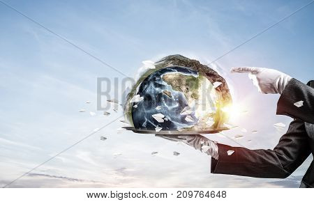 Cropped image of waitress's hand in white glove presenting Earth globe on metal tray and pointing on it with cloudy skyscape on background. 3D rendering. Elements of this image are furnished by NASA.