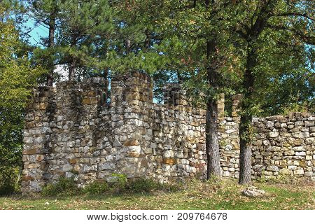 Remains of an ancient fortress in the woods