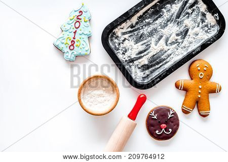 Cook gingerbread for new year 2018. Gingerbread man, rolling pin, flour on white background top view. mock-up