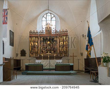 TALLINN, ESTONIA - SEPTEMBER 14: Carved altar in Holy Spirit Church on September 14, 2017 in Tallinn, Estonia. The altar dates from 1483