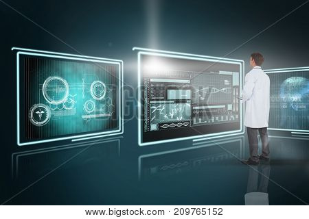 Young doctor using 3D tablet pc against composite image of different application interface