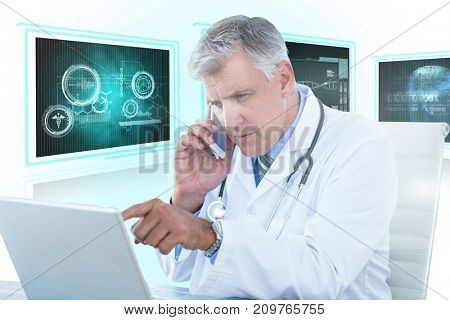 Male doctor pointing at laptop while using mobile phone against white background with 3D vignette