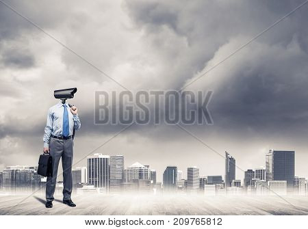 Elegant businessman outdoors with papers in hands and camera instead of head