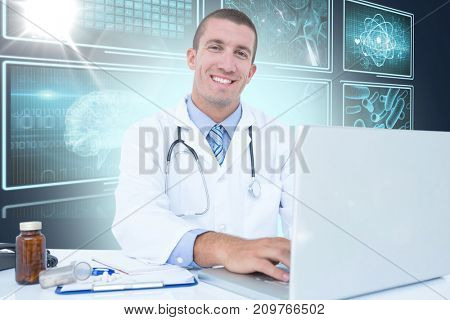 Portrait of smiling businessman using laptop against composite 3D image of different interface