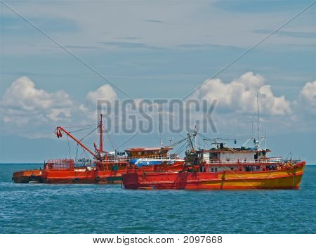 Fishing boats at rest in Bacolod bay Philippines. A major port for Occidental province and the central Visayas region poster