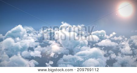 Idyllic view of bright sun over cloudscape against blue sky during sunny day