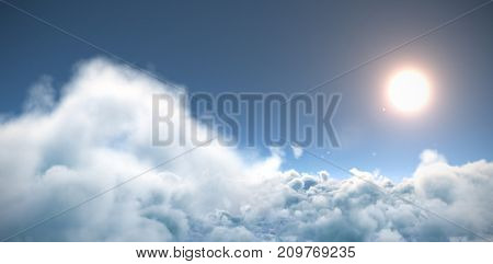 Idyllic view of sun over cloudscape against blue sky during sunny day
