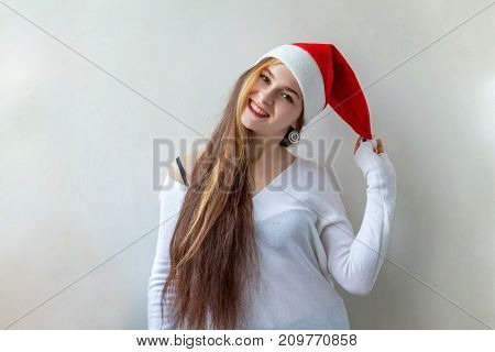 Santa girl smiling in red Santa hat. Christmas Santa hat isolated woman portrait . Smiling happy girl on white background.