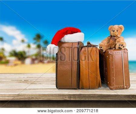 Large retro suitcases new year santa hat travel concept object