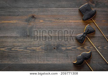 Happy Father's day present cards. Black tie, mustache and hat cookies. White desk background top view mockup