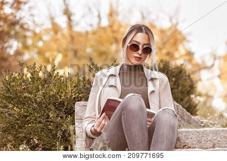 She Loves To Read A Book And Relax Outdoors