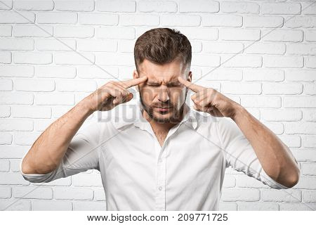 Head man fingers touching young adult man face background