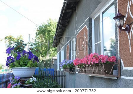 flower designing for windows or terrace cottage houses