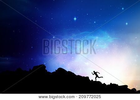 Confident male athlete running from starting blocks against digitally generated image of colorful lights