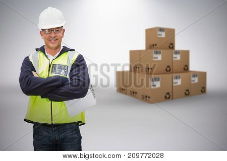 Composite 3D image of worker wearing hard hat in warehouse against grey background