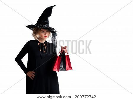 Halloween Shopping. Happy Woman In Witch Halloween Costume