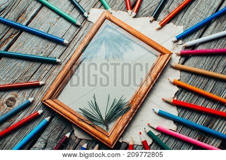 Christmas Composition ,photo Frame On The Wooden Table With Tree Branches With Pencils