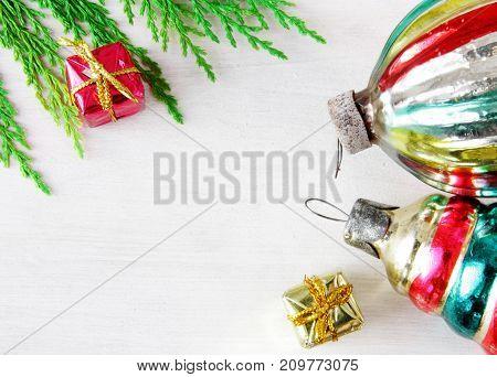 retro glass christmas toys on white wooden panel