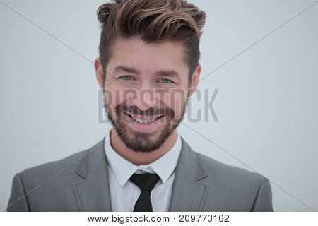 Close up portrait of a smiling handsome business man  over white