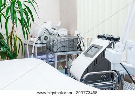 Modern Laser Massage Equipment In The Beauty Salon Or Physiotherapy Clinic. Selective Focus. Healthy