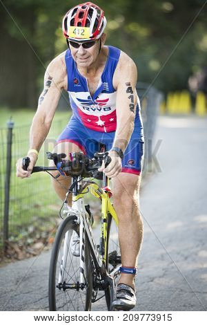 NYC Triathlon Race, competing athletes bike 40 kilometers including in Riverside Park in Manhattan in the only International Distance triathlon in New York City, NEW YORK: JUL 16 2017.