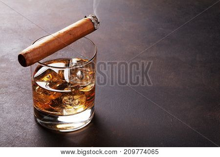 Whiskey with ice and cigar. With copy space