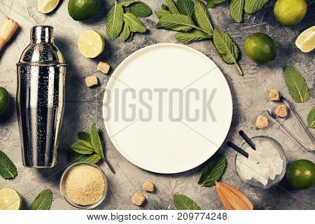 Mojito cocktail ingredients on rustic background