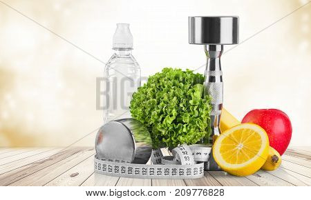 Tape dumbbells fruits sport objects background small