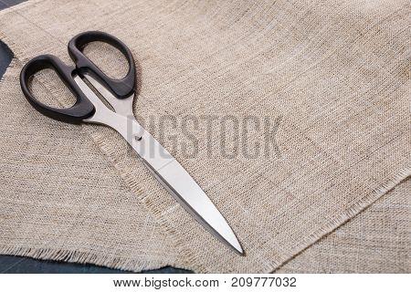 Portnevsky Scissors On A Background Of Linen Cloth.