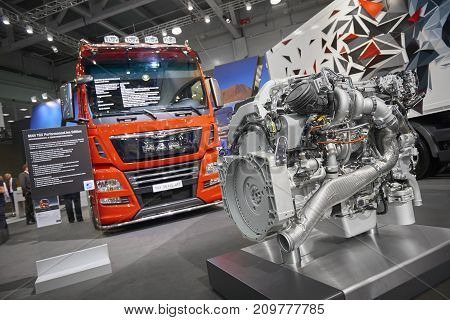 MOSCOW, SEP, 5, 2017: View on red MAN truck and diesel truck engine - exhibits on Commercial Transport Exhibition ComTrans-2017. MAN trucks. Automobile industry. Popular and newest Commercial trucks