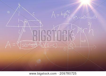 Algebric calcualtion on black background against sunrise sky